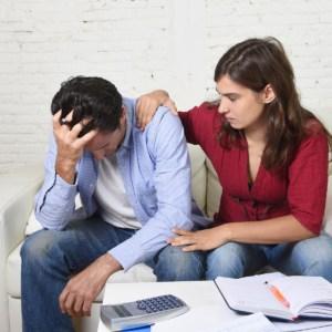 couple worried stress over bills
