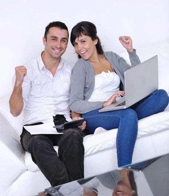 couple happy laptop