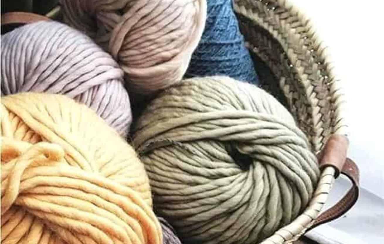 wool yarn balls in basket