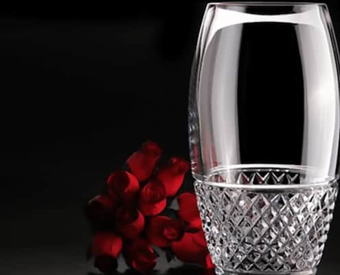 crystal drinking glass cleaned with denture tablet with red roses in background