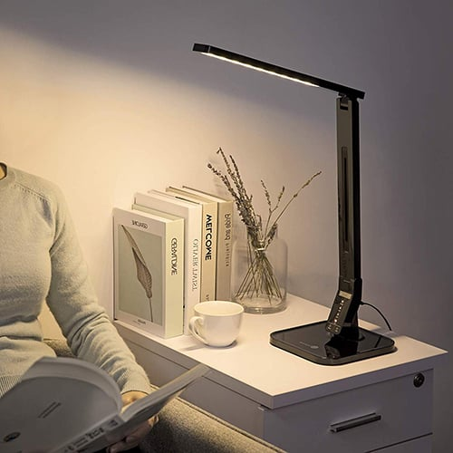 A person sitting on a desk