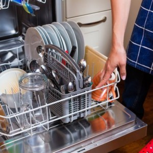 dishwasher open to reveal clea dishes and utensils