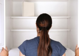 woman looking into empty pantry