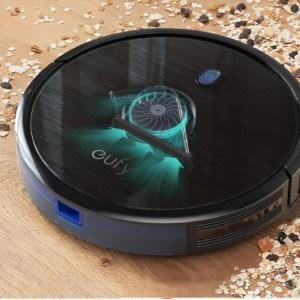 eufy robovac 11S black vac on wood floor showing how it picks up debris