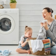 family folding laundry softened with homemade softener