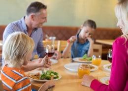 Family having dinner in restaurant