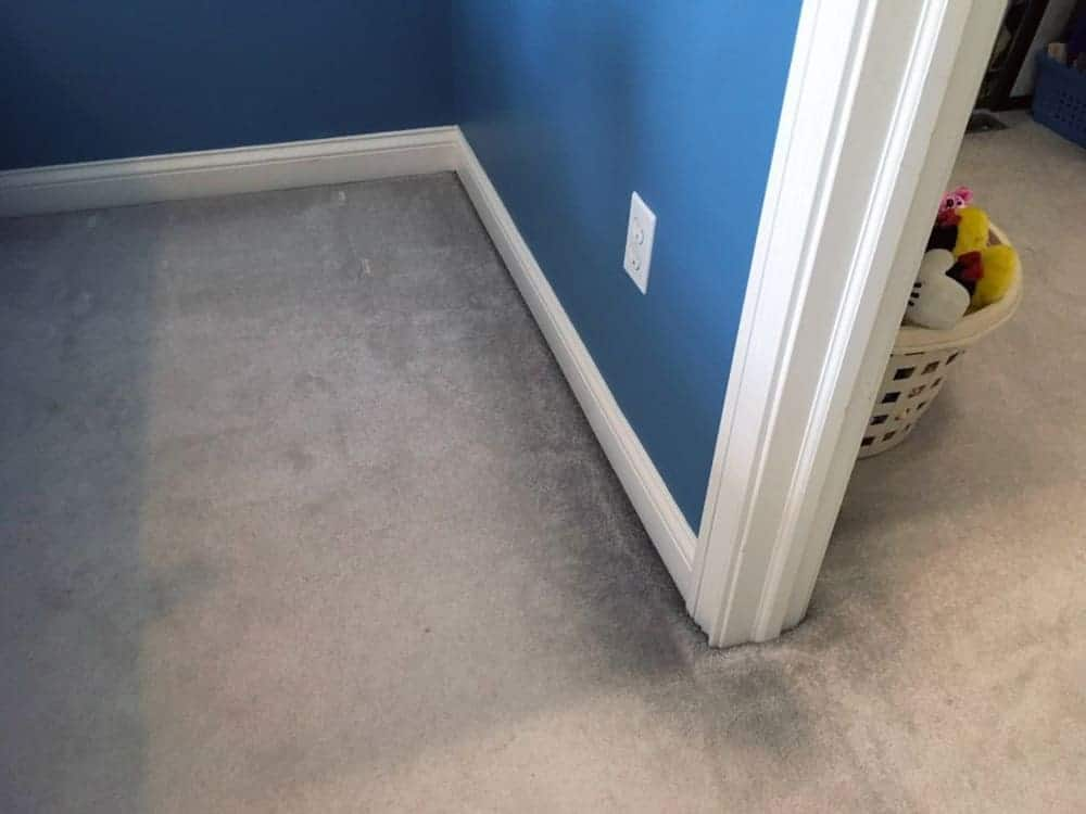Ugly, grimy, black lines on edges of carpet that are from filtration soil
