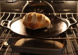 A close up of a metal pan on a stove top oven, with Dough and Yeast