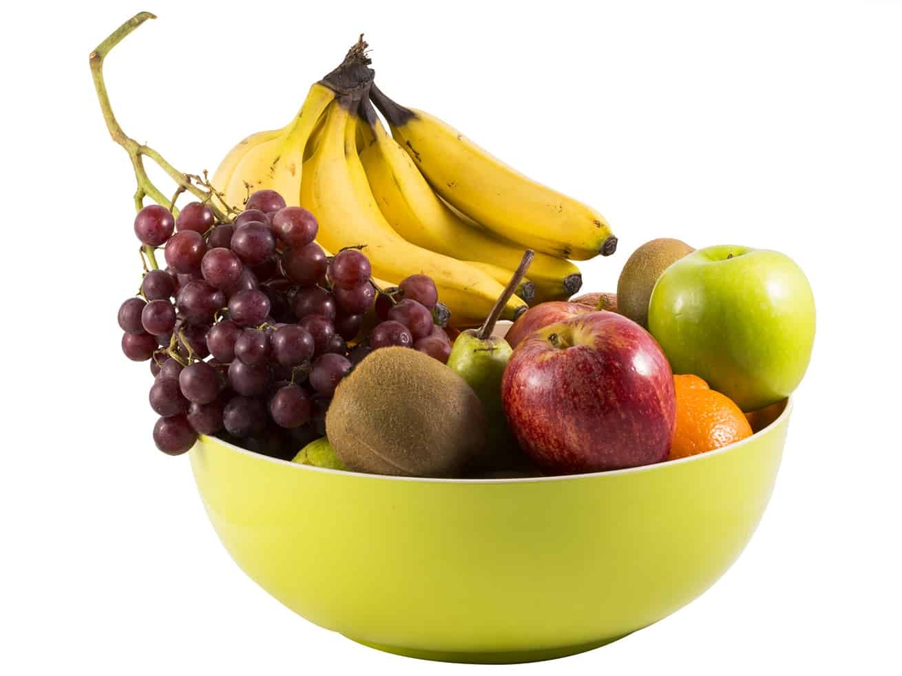 green fruit bowl filled with ripe fruit