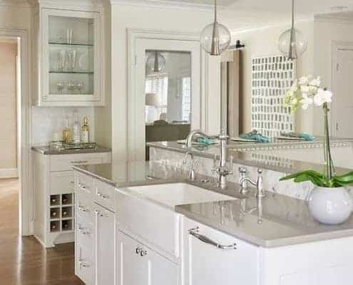 Beautiful white kitchen with gray quartz countertops