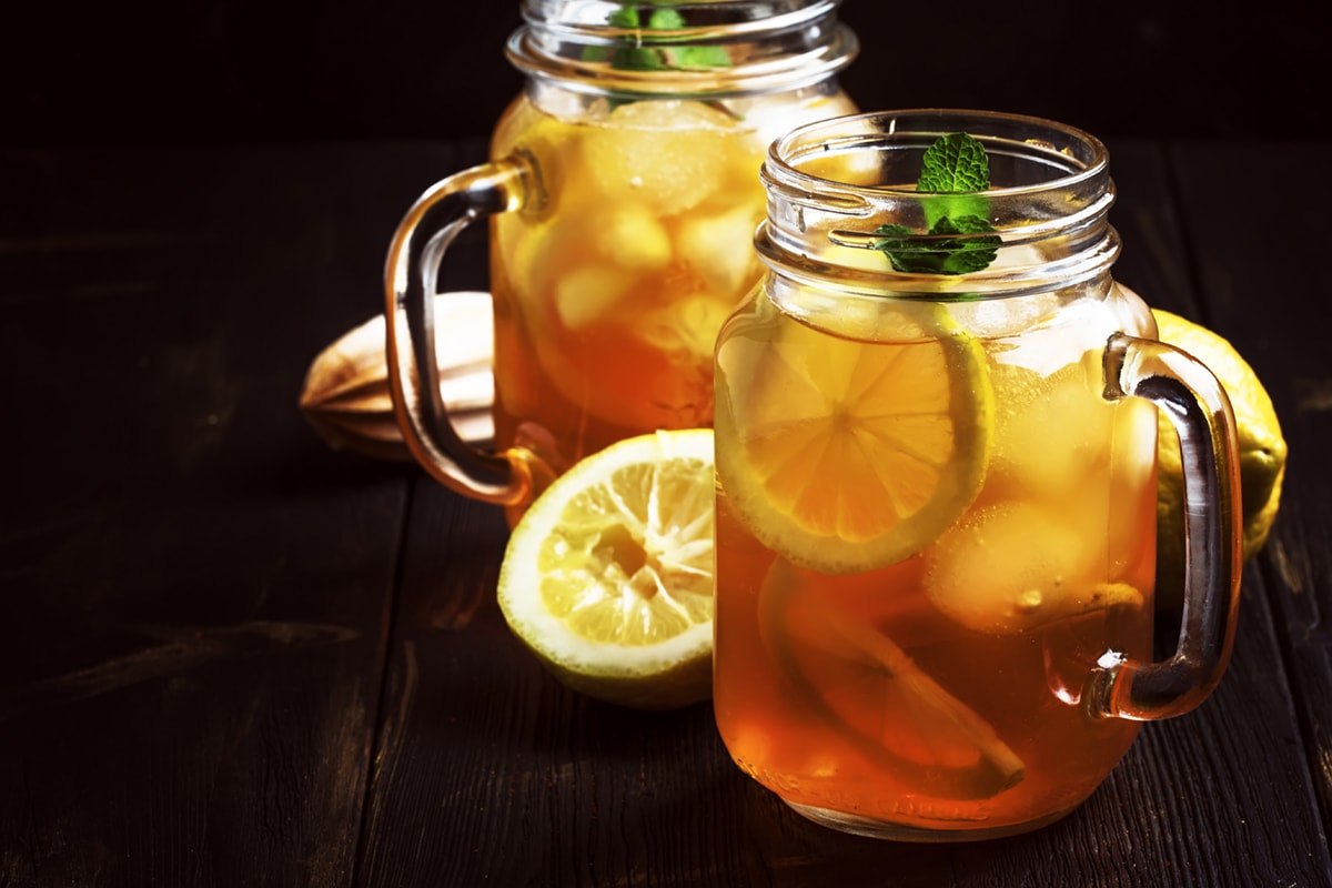 two glass mugs iced tea with lemon