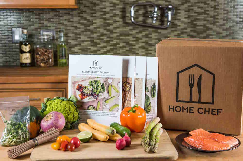 Home Chef box with all of its contents on the counter demonstrating how complete it is