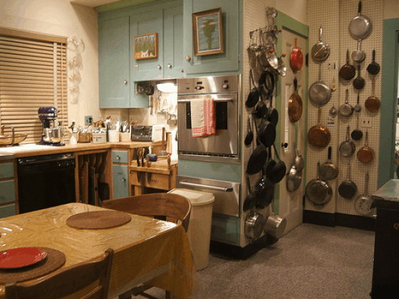 Julia Child's kitchen with huge peg board for organization