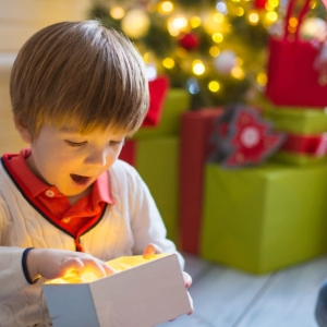 little boy with xmas learning toy