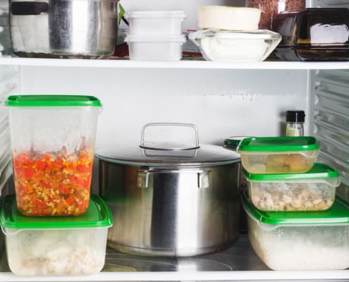 Open refrigerator with food in kitchen. Food supply for a week.