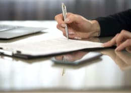 female hands signing legal documents