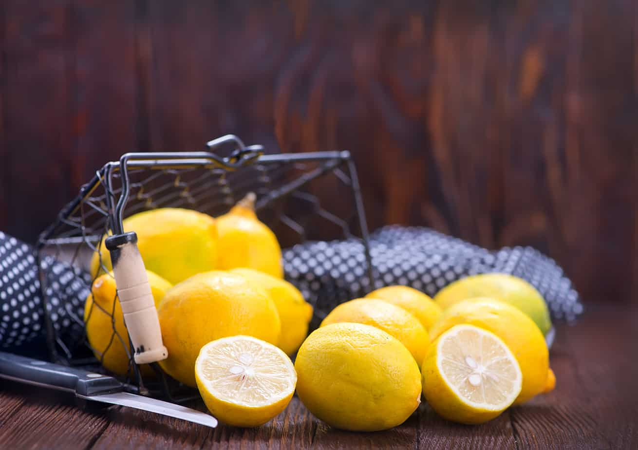 fresh lemons in basket and on a table