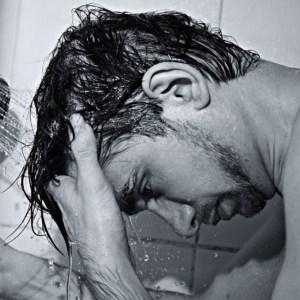 male in shower washing hair