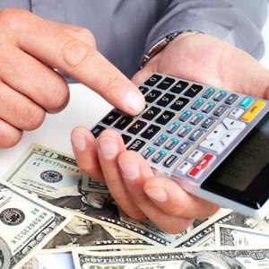 hand with a calculator. money saving concept.