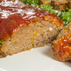 A close up of food on a plate, with Meatloaf