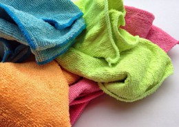 bright colored cleaning cloths on white counter