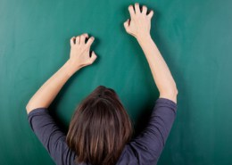 closeup rear view of frustrated woman scratching chalkboard