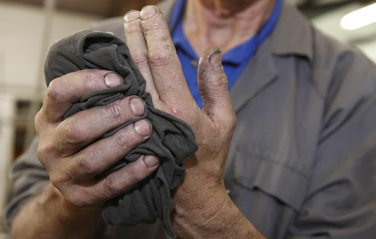 mechanic holding greasy oily rag