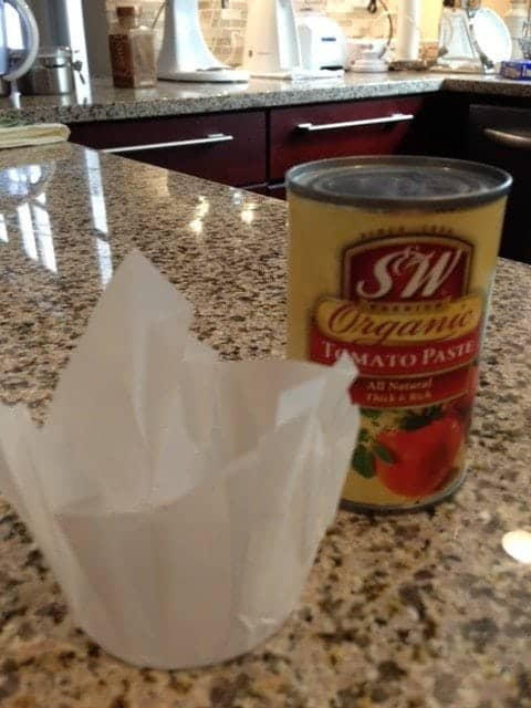 Can with parchment paper on kitchen counter top