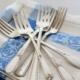 silver flatware forks on linen napkin