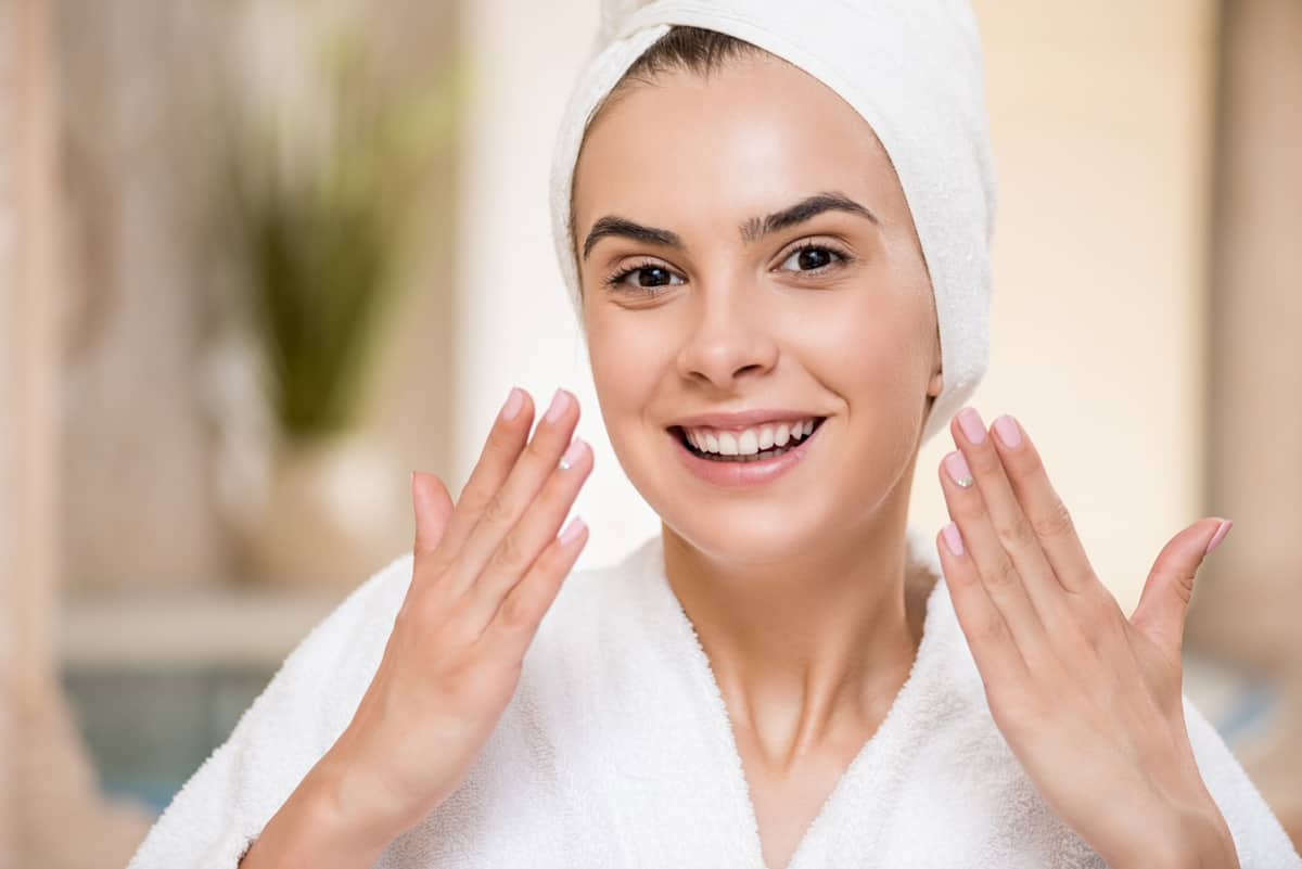 woman with perfect clean face after using body scrub