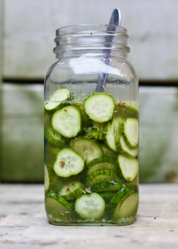 A close up of a wine glass, with Cucumber