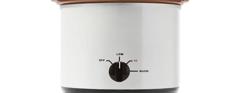 vintage white slow cooker on white background