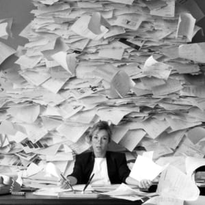 office-worker-with-mountain-of-mail
