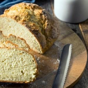 loaf of no-yeast soda bread on cutting board