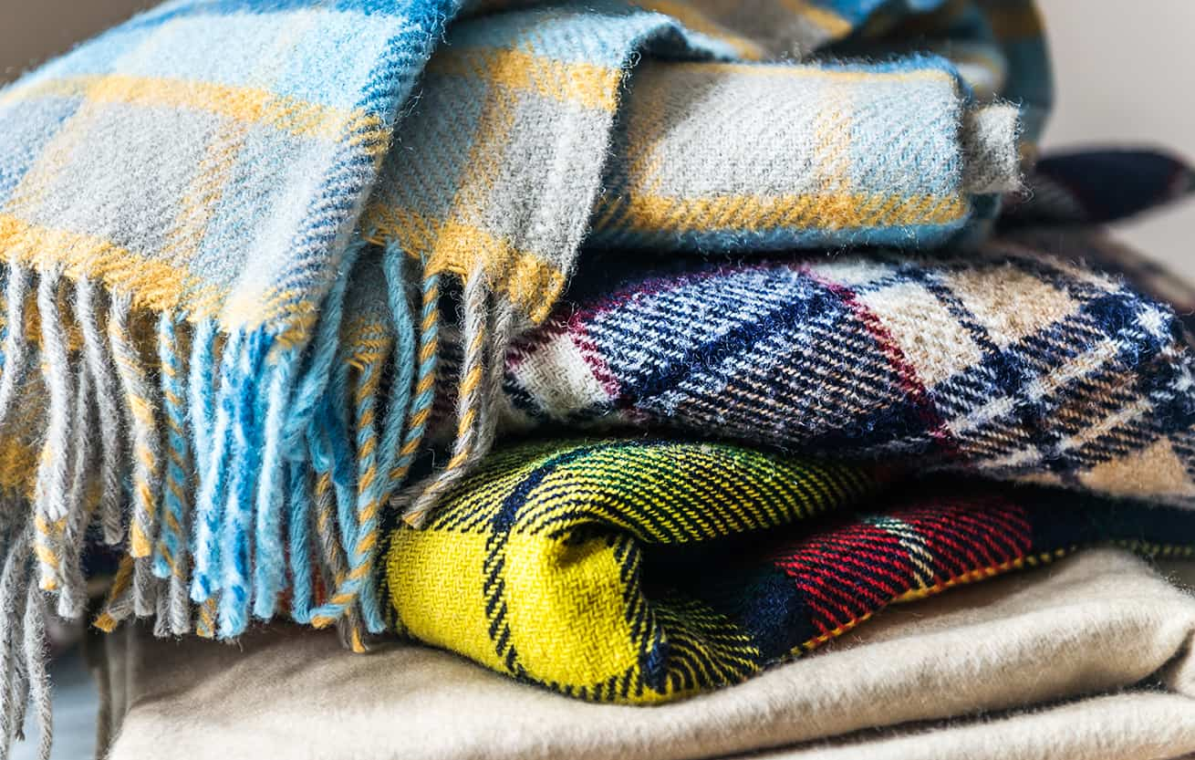Stack of woolen plaid blankets