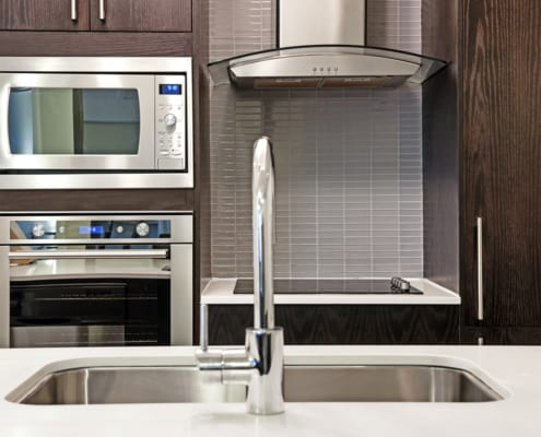 Modern luxury kitchen interior with stone countertop and stainless steel appliances