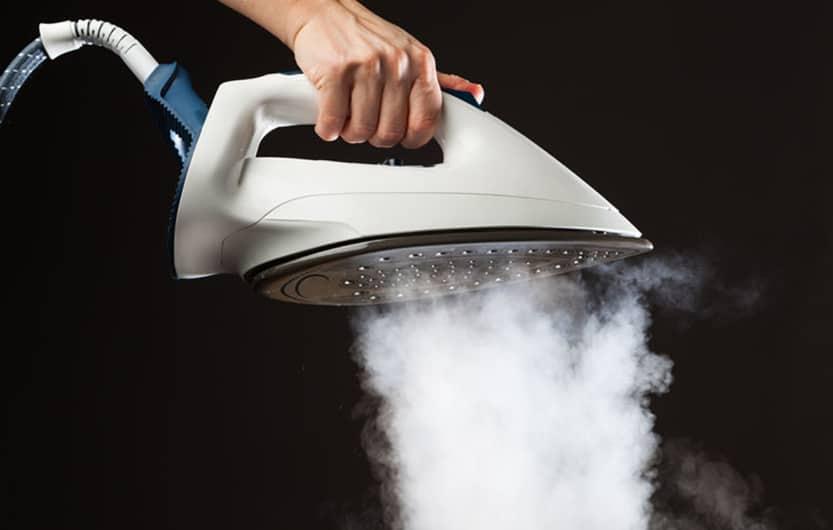 hand holding steam generator iron