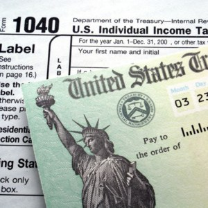 U.S. tax return check on 1040 form background