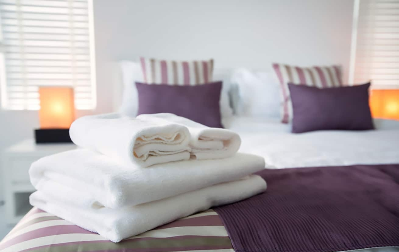 towels linens on a beautiful bedBath towels on the bed of bedroom
