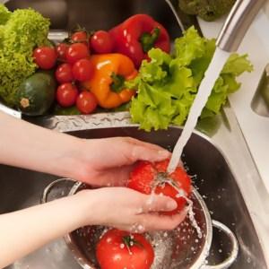 fresh vegetables splashing in water before cooking