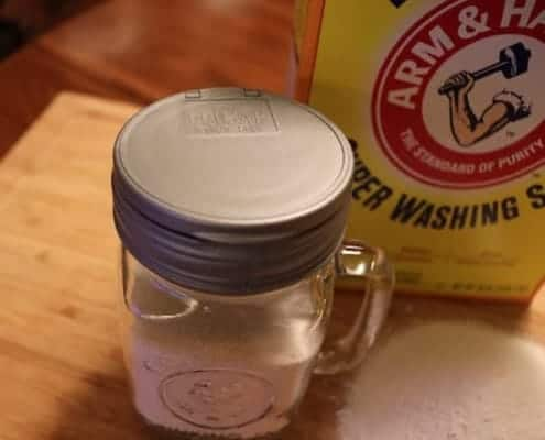 jar with closed shaker top sitting on a table with a box of washing soda