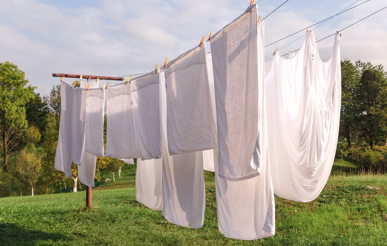 fresh clean items drying on a clothes line rather than in a clothes dryer