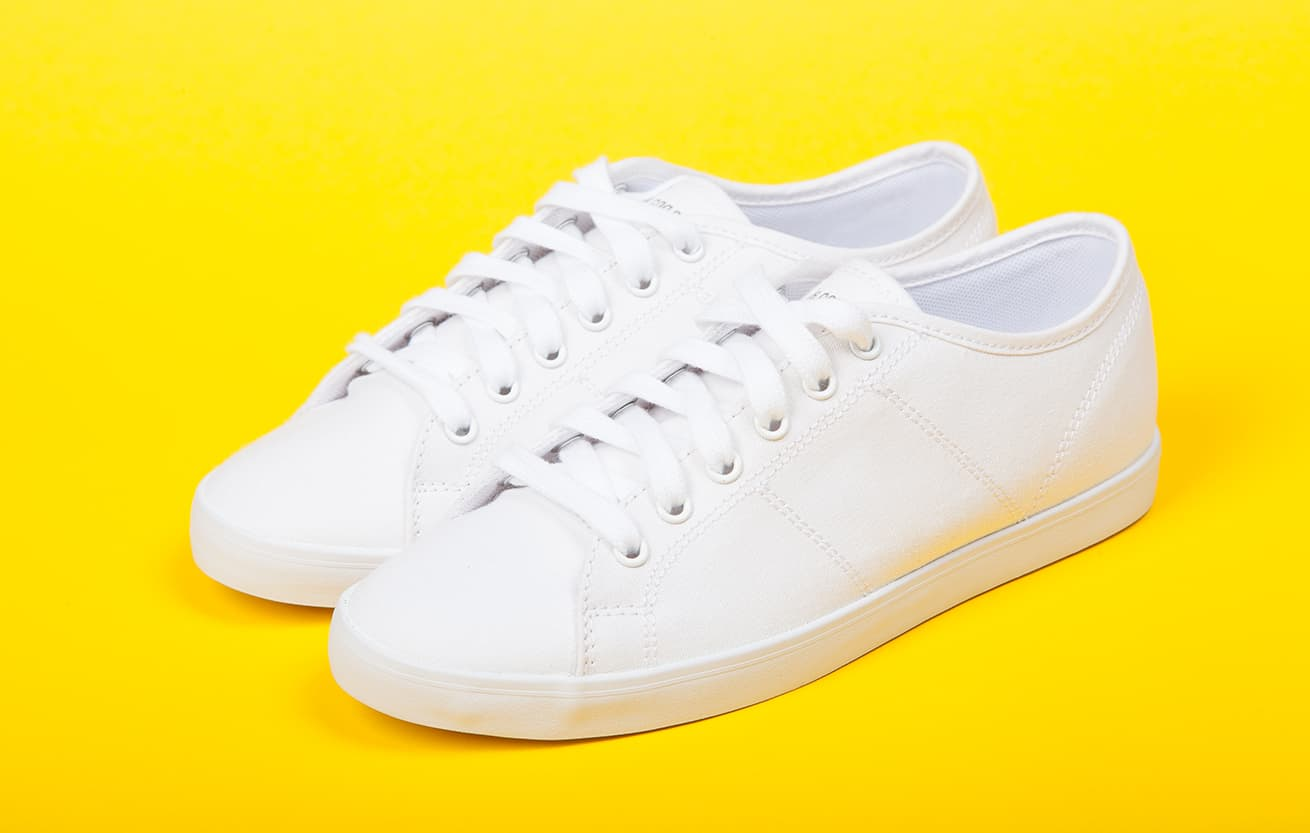Pair of new white sneakers that should never go in a clothes dryer