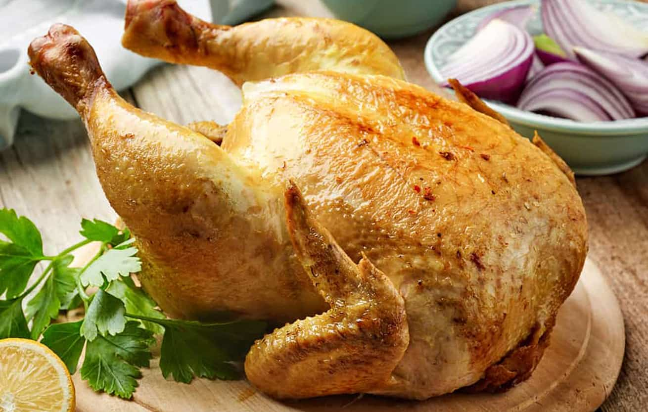whole-roasted-chicken on a wood platter