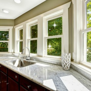 A double sink with a large window