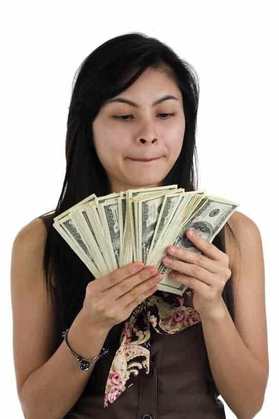 woman money wondering pondering spending