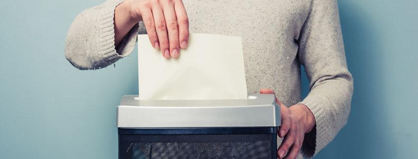 oman shredding a piece of paper