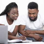 young-black-couple-planning-budget-together-at-home